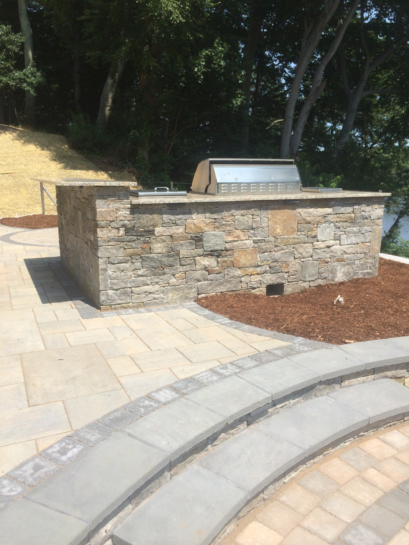 Natural Stone Outdoor Kitchen and Outdoor Bar with Stainless Steel Appliances by Bahler Brothers in Cromwell, CT