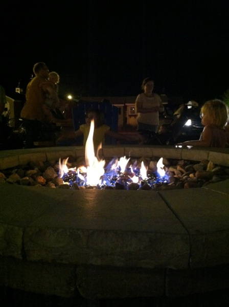 A gas fire pit built by Bahler Brothers burns brightly at Kloter Farms in Ellington CT