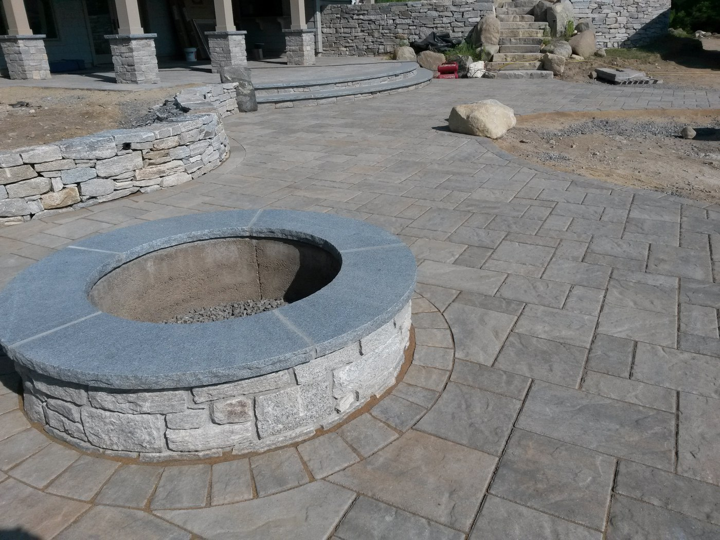 Natural stone fire pit and Sitting Wall in Wilbraham, MA by Bahler Brothers