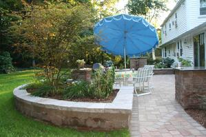 Paver Patio with Outdoor Kitchen and Fireplace and Raised Landscape Beds
