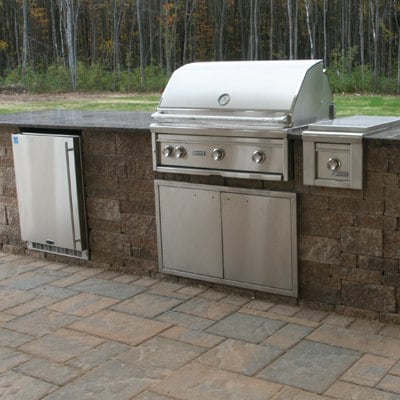 Outdoor Grill Island with Lynx Grill and Side Burner on Patio by Bahler Brothers in CT, Western MA
