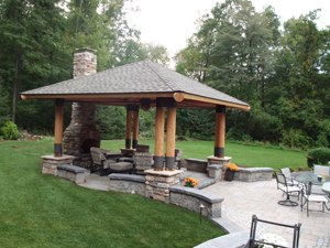 Multi-Level Paver Patio with Stone Fireplace and Bungalow