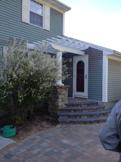 Pergola off house with Column and Paver Steps