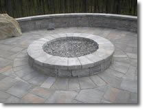 stone fire pit built by Bahler Brothers