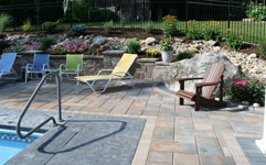 paver pool patio with retaining walls and dry creek bed