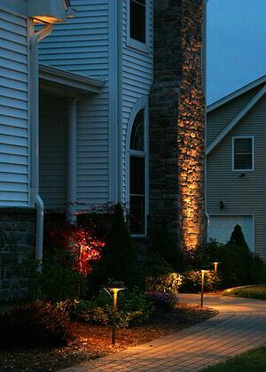 Landscape Lighting on Walkway and Uplighting a Chimney