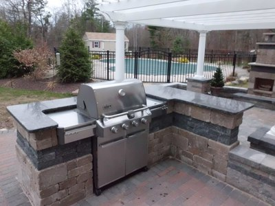 Outdoor Kitchen with Bar and Built in Grill with Pergola