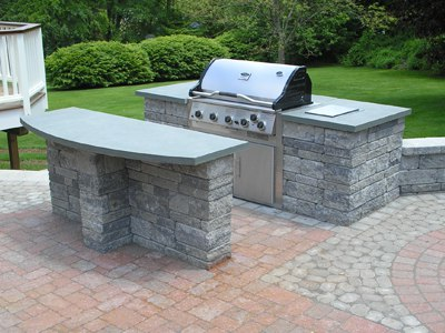 Outdoor Kitchen with Built-in Grill and Serving Island