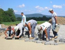 paver crew installing a paver driveway