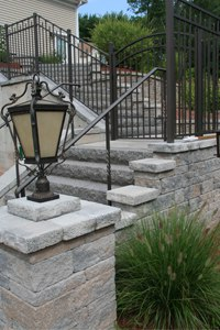 pillar with light at base of steps