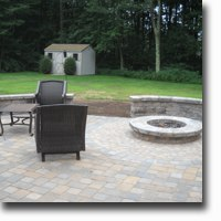 Patio with sitting walls and fire pit