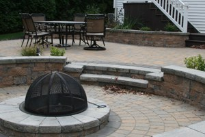 sunken fire pit with steps and sitting walls
