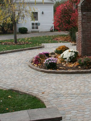 Walkway with polymeric sand in the joints.