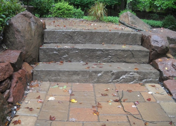 big slab steps in the middle of a walkway.