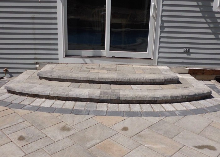 Large landing with curved steps.