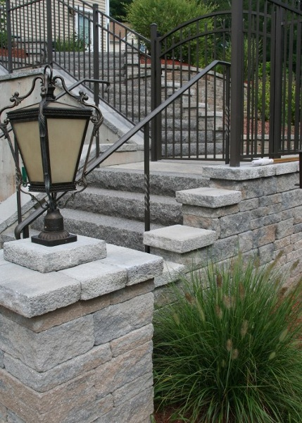 A pillar at the bottom of steps to welcome in all guests.