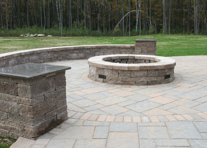 A sitting wall around the fire pit for not only a boundary, but for siting as well.