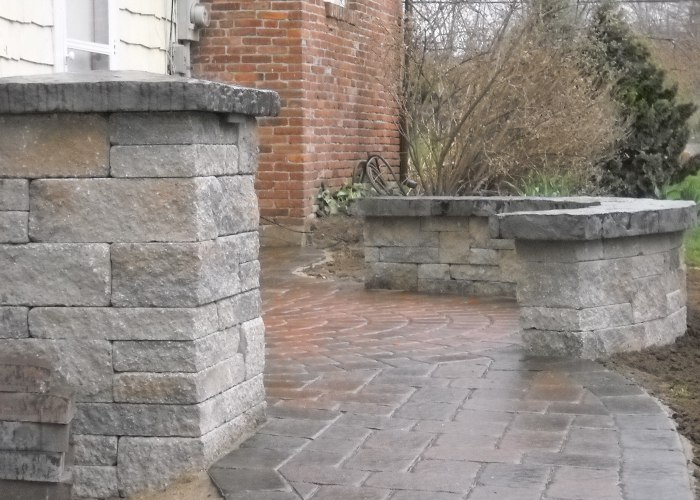 A sitting wall lining a walkway for a touch of a vertical element.