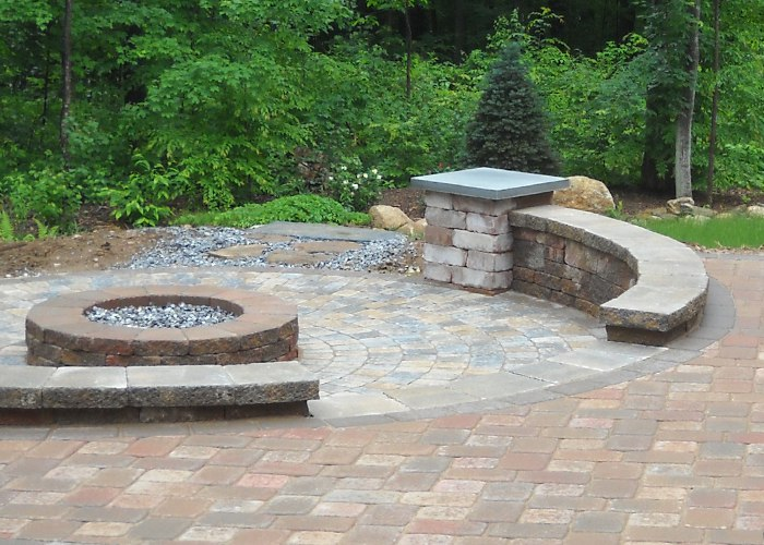 A sunk in fire pit with sitting walls around the edge.
