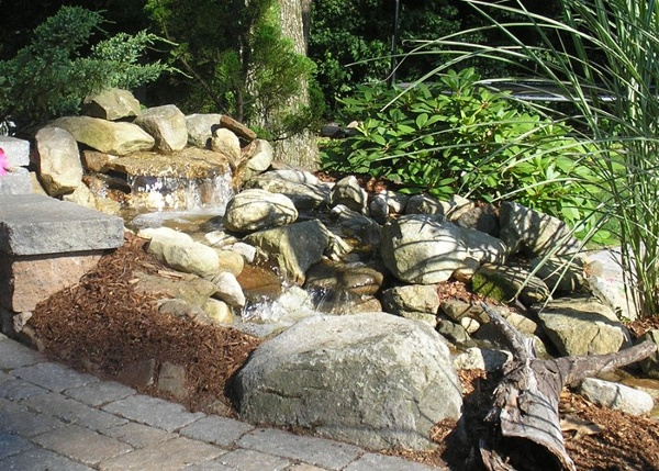 small water feature beside a patio in Ellington, CT installed by Bahler Brothers