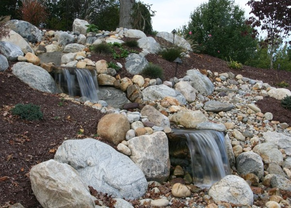 large pondless water feature in Somers, CT. installed by Bahler Brothers