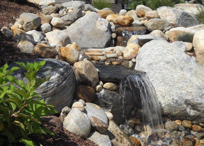 waterfall detail of a water feature in Ellington, CT installed by Bahler Brothers