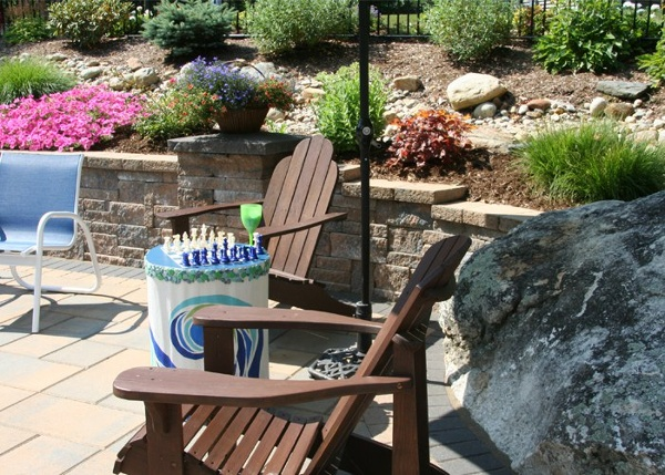 Landscaping around a pool patio by Bahler Brothers in CT