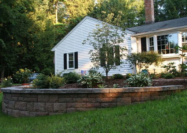Traditional Front foundation planting with retaining wall by Bahler Brothers in CT