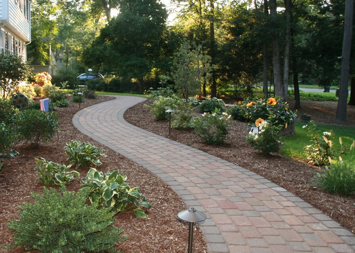 Traditional paver front walkway is flanked on both sides by beautiful landscaping by Bahler Brothers in CT