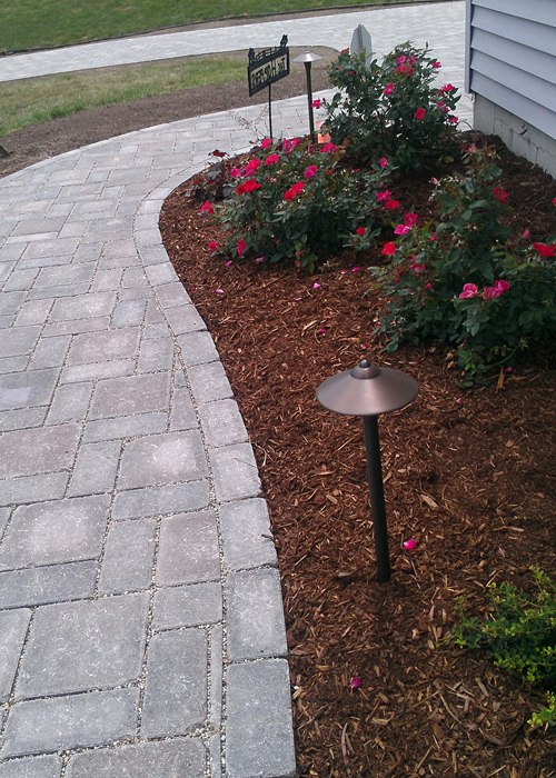 Front walkway with landscape lighting and landscaping by Bahler Brothers in CT