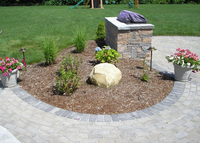 Grill island and patio with landscaping by Bahler Brothers in Ellington, CT
