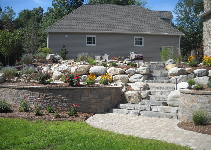 Patio and retaining walls with steps and landscaping by Bahler Brothers in Ellington, CT