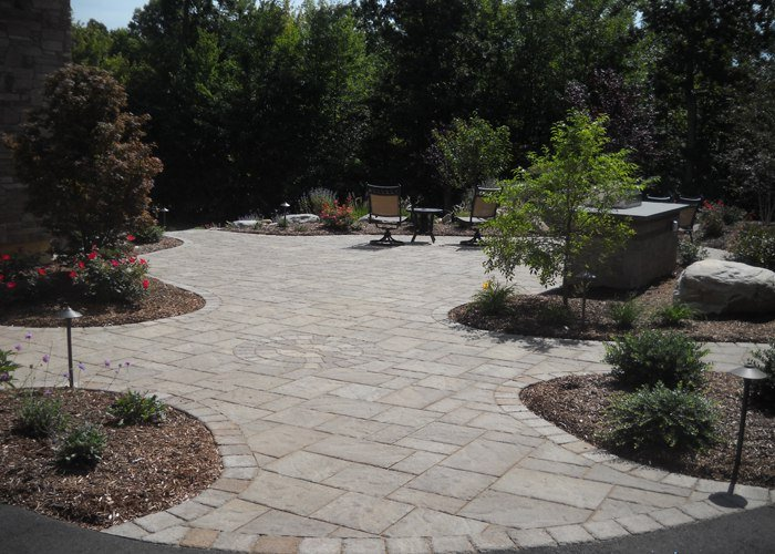 Paver patio with grill island and landscaping by Bahler Brothers in Ellington, CT
