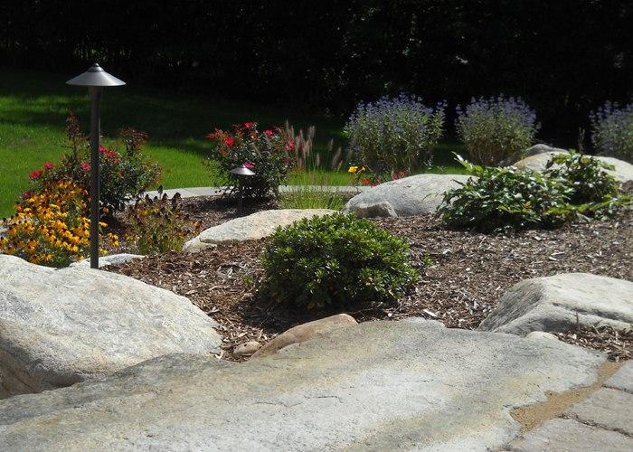 Steps and boulders in landscape bed by Bahler Brothers in Ellington, CT