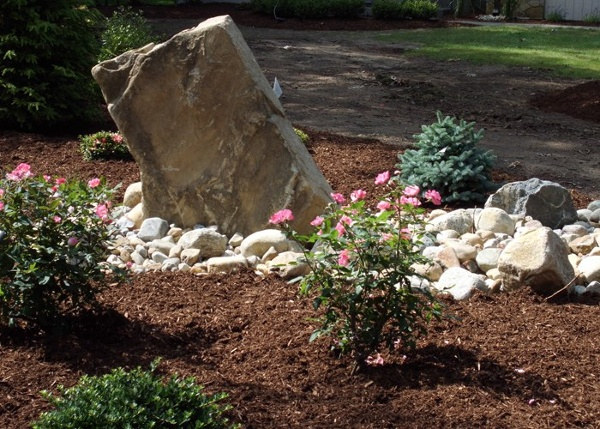 Contemporary Natural Stone focal feature in a landscaping bed by Bahler Brothers in CT