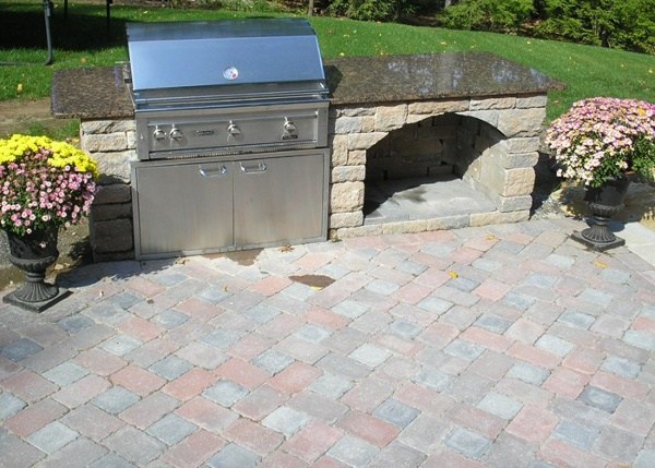 Outdoor Kitchen with Built in Grill and a wood box by Bahler Brothers in South Windsor, CT
