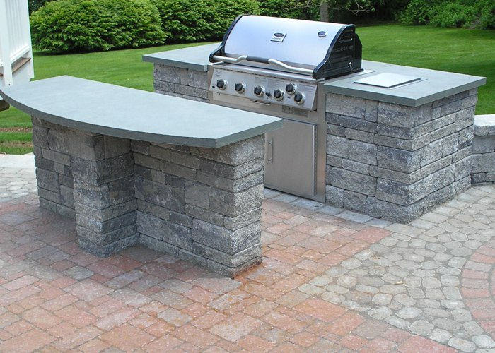 A built-in grill plus a large counter for serving guests or eating a meal.