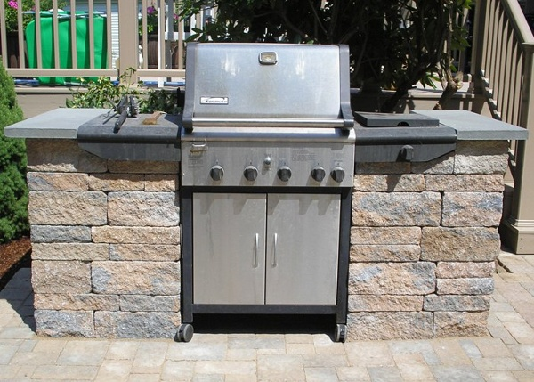 An area for a grill to wheel in is perfect to add more counter space for cooking and preparing BBQ.