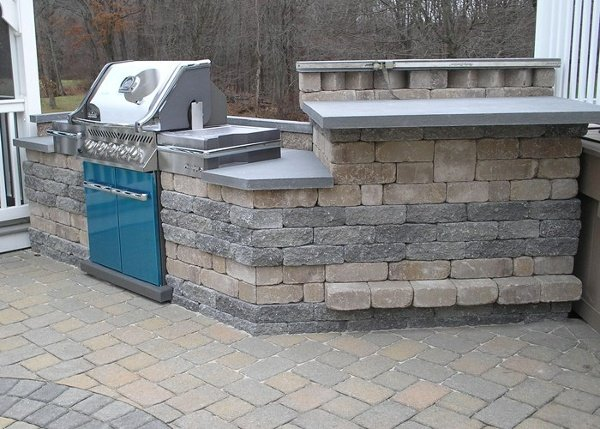 Outdoor Kitchen and Bar with Stainless Steel Weber Grill on Paver Patio by Bahler Brothers in East Windsor, CT