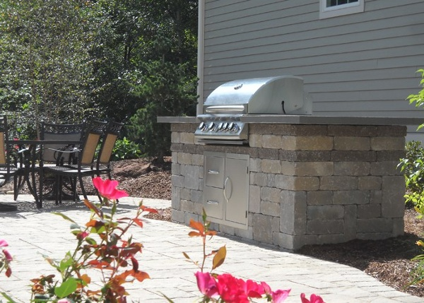 A built-in grill with a blue stone counter top.