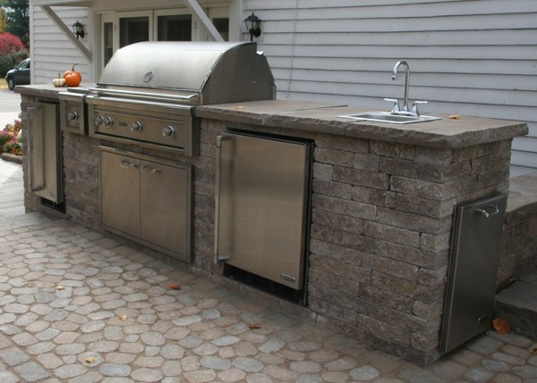 A Fully Equipped Outdoor Kitchen with Built in Grill and other appliances by Bahler Brothers in Suffield CT