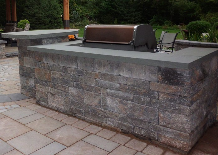 A large built in grill with plenty of counter space.