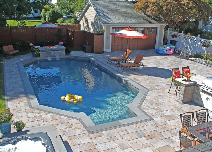 Paver pool patio and driveway in West Hartford, CT. Installed by Bahler Brothers.