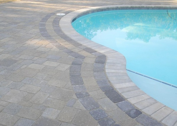 Paver pool patio in Tolland, CT. Installed by Bahler Brothers.