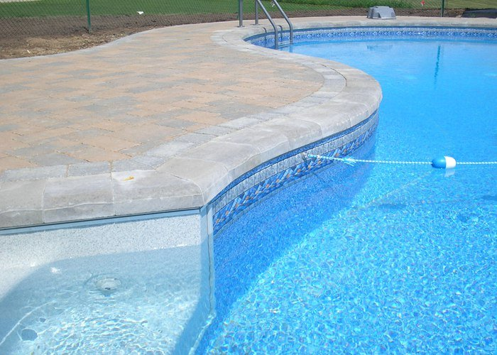 Paver pool patio in Granby, CT. Installed by Bahler Brothers.