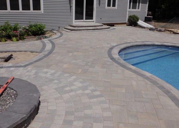 Paver pool patio and retaining wall in Bristol, CT. installed by Bahler Brothers