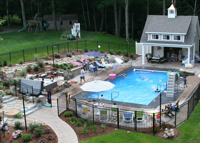 Paver pool patio and retaining wall in Tolland, CT. installed by Bahler Brothers