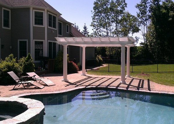 Pool patio and pergola installation in South Windsor, CT. Installed by Bahler Brothers.