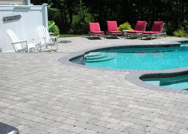 Paver pool patio installation by Bahler Brothers in South Windsor, CT.