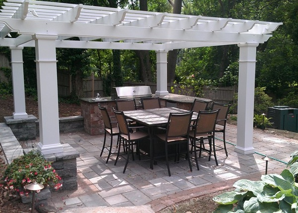 paver patio with a built-in outdoor kitchen, pergola, sitting walls by bahler brothers in South Windsor, CT